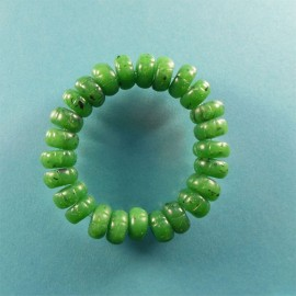 The beads on this handmade polymer clay stretchy bracelet are made to resemble carved jade. It will fit all but the largest wrists.