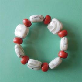 P282 white and orange pillow bracelet