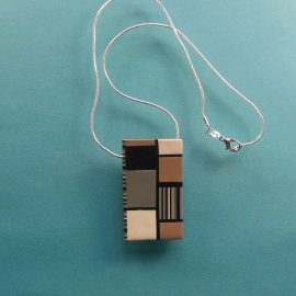 "S344 This rectangular pendant has a muted Mondrian style design in in black white grey and beige. It measures 2"" x 1"" and is suspended on an 46 cm (18 inches) snake chain."