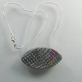 S350 This oval pendant has a random, mainly grey pink and orange mosaic style pattern. It is suspended on an 46 cm (18 inches) snake chain.