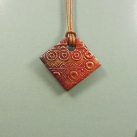 P296 Red and gold textured square pendant