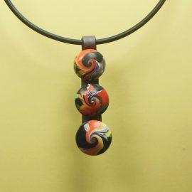 S395 black orange and red 3 swirl bead pendant. £21