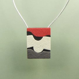 S405 black red white and grey textured pendant. £26